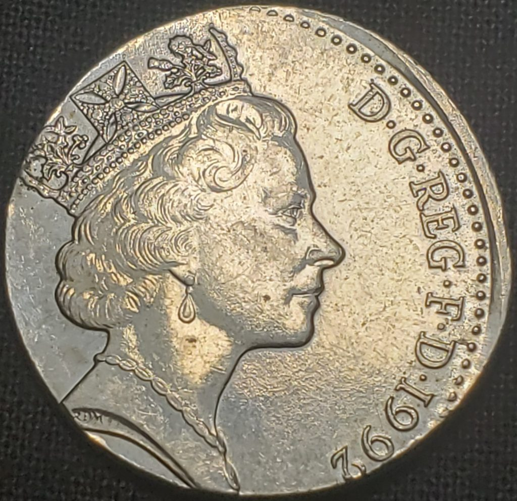 A 1992 United Kingdom Ten Pence struck on a wrong planchet. The year and weight suggests that the planchet used was a 5 Pence planchet.