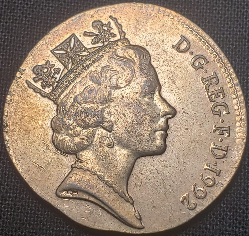 Obverse of a United Kingdom Two Pence coin struck on a Penny planchet