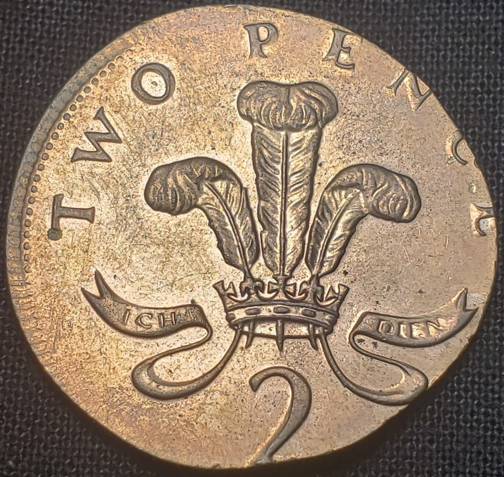 Reverse of a United Kingdom Two Pence coin struck on a Penny planchet