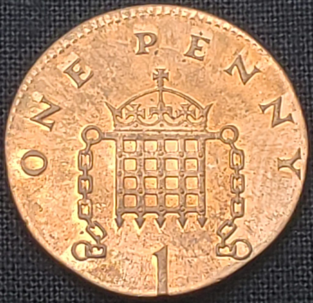 Reverse of a 1998 United Kingdom One Penny Struck on a foreign planchet. The planchet weight is 2.36 grams. The planchet is magnetic.