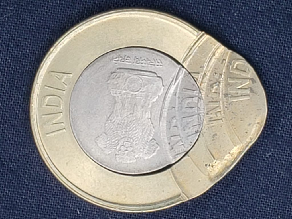 Obverse of a 2020 Ten Rupees that has been struck multiple times