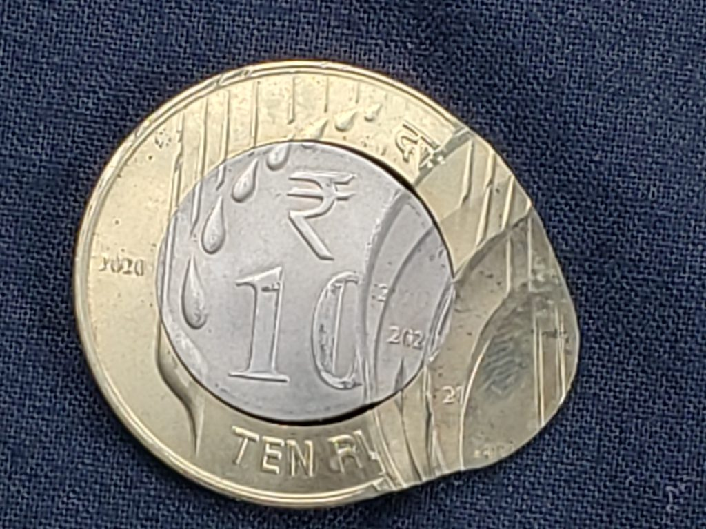 Reverse of a 2020 Ten Rupees that has been struck multiple times