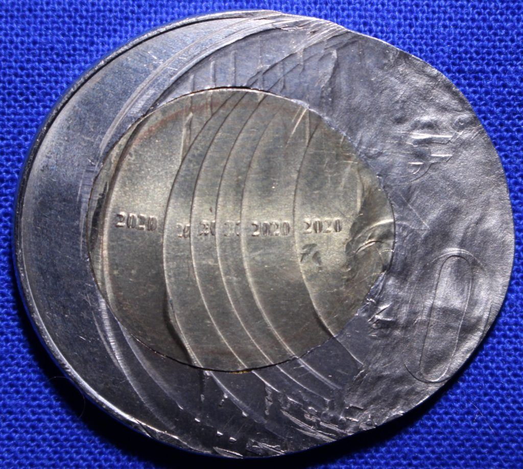 Reverse of a 2020 India 20 Rupee coin with at least seven strikes. This multi-struck coin still has decent eye appeal and a large number of strikes. A great example.