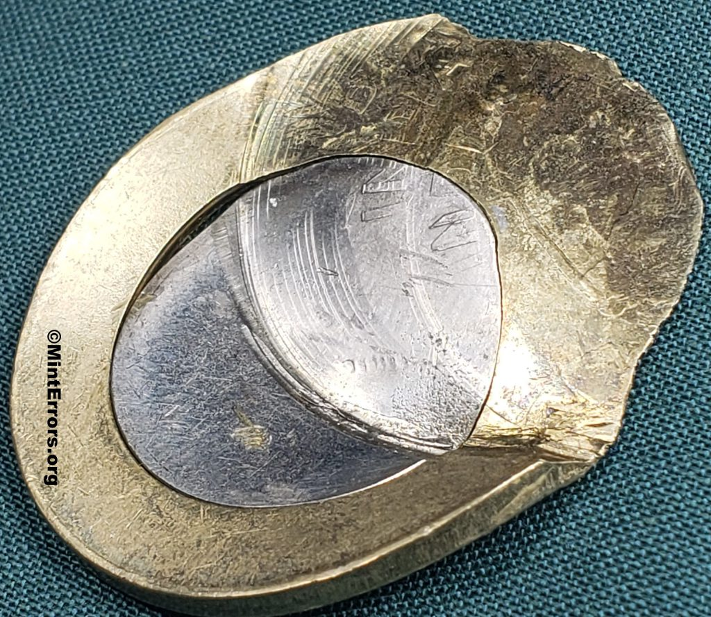 """A 2020 India Ten Rupees that has been multi-struck, giving the coin the appearance of a """"toilet seat""""."""