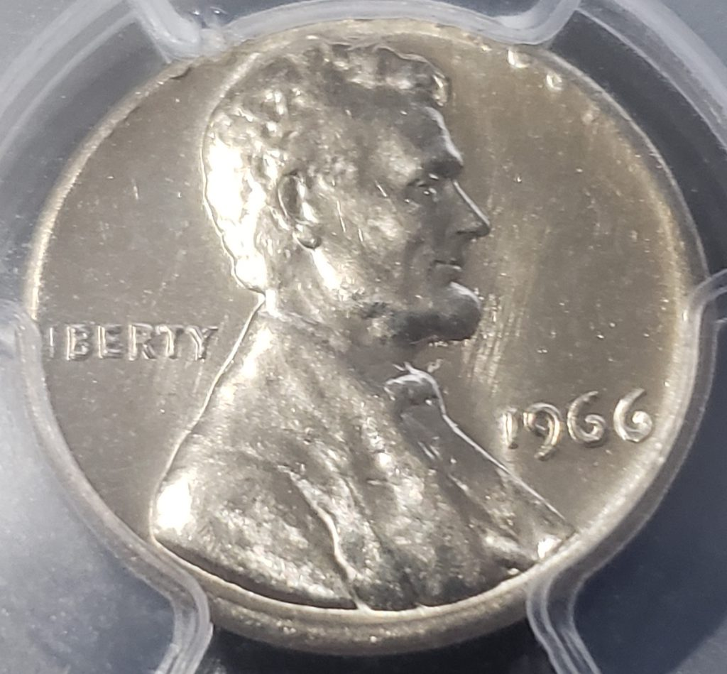 Struck on wrong planchet -  The Obverse of a 1966 Lincoln Cent struck on clad dime planchet