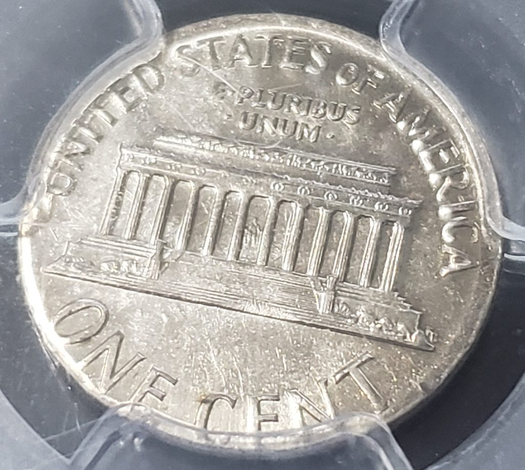 Struck on wrong planchet -  The Reverse of a 1966 Lincoln Cent struck on clad dime planchet