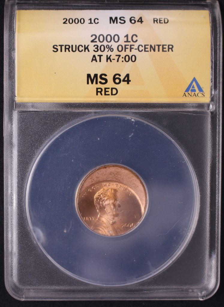 Off center coin - Lincoln Cent with date.